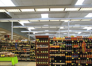 English: Shelves of packaged food inside a Ral...
