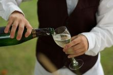 Wine service pouring a glass of the Italian sp...