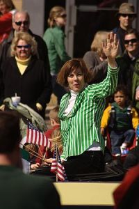 Dane County Executive Kathleen Falk waves to t...