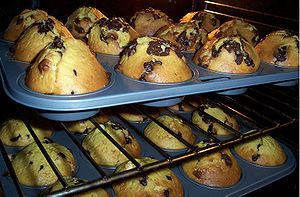 Chocolate chip muffins baking in an oven