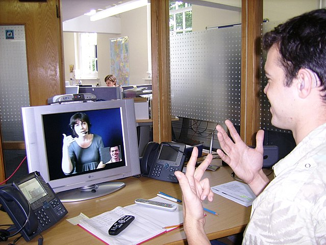 FileDeaf or HoH person at his workplace using a Video Relay Service