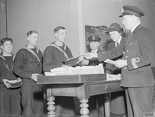 File:Payday at HMS Wellesley 1942 IWM A 8026.jpg - Wikimedia Commons