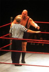 English: The Big Show arguing with referee Sco...