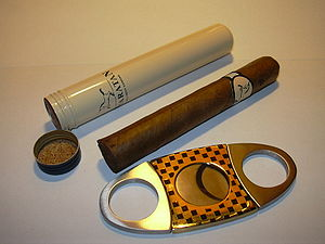 A semi-airtight cigar storage tube and a doubl...