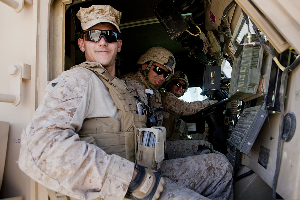 FileFrom left, US Marine Corps Cpl Michael Perialas, a combat