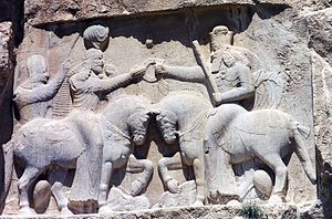 Ahura Mazda (right, with high crown) invests A...