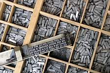 Movable metal type, and composing stick, descended from Gutenberg's invention