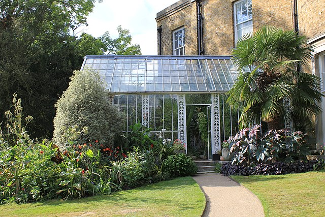 This conservatory's owner uses it solely for horticulture, so it is almost entirely of a glass construction
