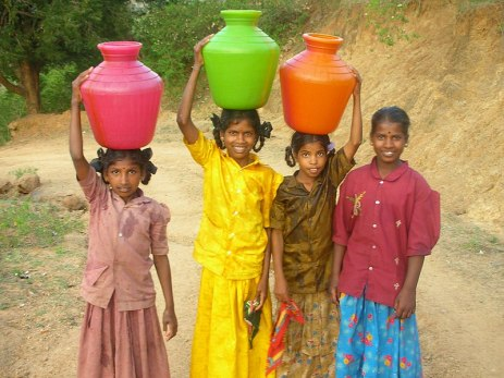 File:Girls carrying water in India.jpg