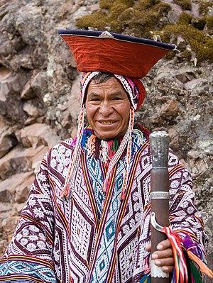 An Andean man in traditional dress. Pisac, Peru.