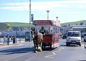 A horse tram passes a pedestrian crossing. Dou...