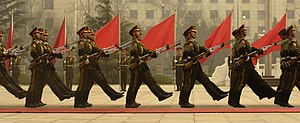Members of a Chinese military honor guard marc...