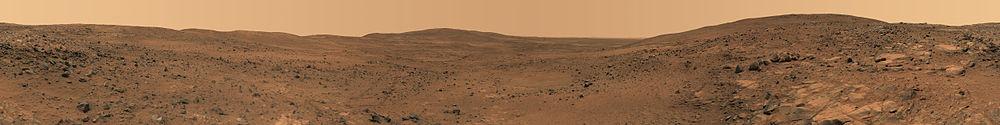 Панорамна гледка в почти реални цветове към повърхността на Марс. Заснета е от марсохода Спирит.