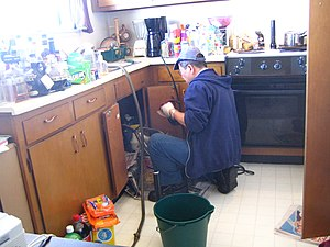 A Plumber at work.