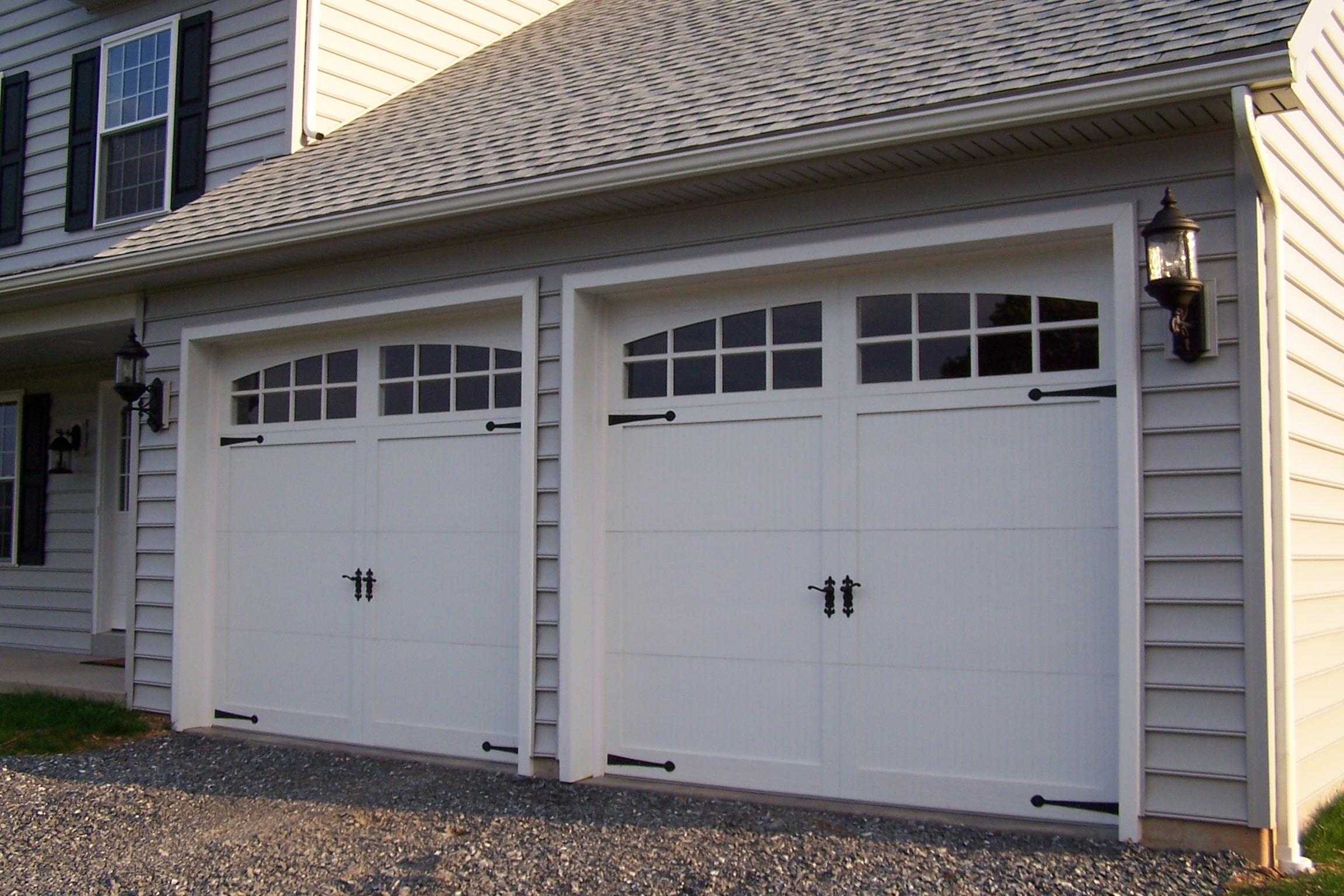 Sectional type steel with exterior cladding overhead garage doors in the style of old carriage house doors