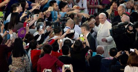 Pope Francis is greeted as he arrives for a meeting with families at the Mall of Asia Arena in Manila. (Alessandra Tarantino, AP)