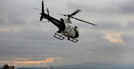 An LAPD helicopter flies over downtown Los Angeles, where the department is pioneering the use of choppers to prevent crime. (Allen J. Schaben / Los Angeles Times)