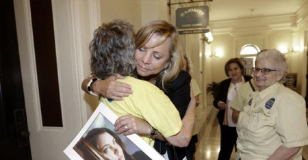 After a right-to die measure was approved by the California Assembly on Sept. 9., Debbie Ziegler holds a photo of her daughter, Brittany Maynard, a 29-year-old California woman with brain cancer who moved to Oregon to legally end her life. (Rich Pedroncelli / Associated Press)