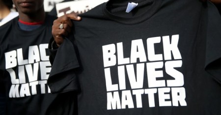 "A protester holds a ""Black Lives Matter"" T-shirt during a ""Hands Up, Don't Shoot"" demonstration in front of the San Francisco Hall of Justice on Dec. 18 in San Francisco. (Justin Sullivan/Getty Images)"