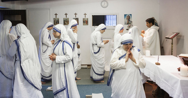 Sisters of the Missionaries of Charity, the religious congregation founded by Mother Teresa in 1950, receiving communion during Mass at a motherhouse in Rome last week. (Credit: Gianni Cipriano for The New York Times)