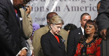 Hillary Clinton prays with Merdean Gales of St. Louis after addressing the New Baptist Covention on Jan. 30, 2008, in Atlanta. (Robyn Beck/AFP/Getty Images)