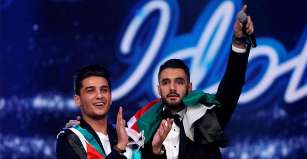 "Yacoub Shaheen, right, celebrates his victory in the finale for Season 4 of the ""Arab Idol"" program. Season 2 winner Mohammed Assaf accompanies him. (Reuters)"