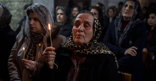 Women prayed at a Christmas mass on Dec. 24 in the Mar Shimoni Church in Bartella, Iraq, which had recently been liberated from Islamic State. (PHOTO: CHRIS MCGRATH/GETTY IMAGES)