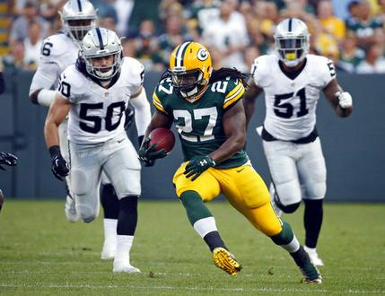 FILE - In this Aug. 18, 2016, file photo, Green Bay Packers running back Eddie Lacy (27) rushes against the Oakland Raiders during the first half of an NFL preseason football game in Green Bay, Wis.  Lacy's agent says the former Green Bay running back is joining the Seattle Seahawks. Lacy's management group, Sports Trust Advisors, said Tuesday, March 14, 2017, on Twitter that the four-year veteran has agreed to terms with the Seahawks. (AP Photo/Mike Roemer, File)