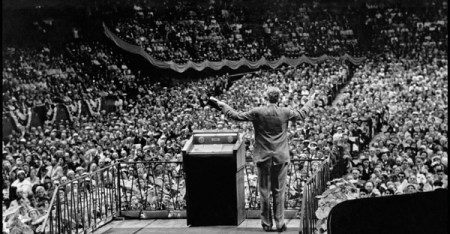 Billy Graham preaching at Madison Square Garden, 1957. (Credit: Cornell Capa/International Center of Photography, via Magnum Photos)
