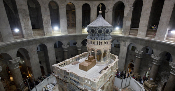 The Edicule in Jerusalem's Church of the Holy Sepulchre is traditionally believed to be the site of Jesus' tomb. A $4 million restoration project, led by a Greek team, has cleaned and reinforced the structure. (Sebastian Scheiner/AP)