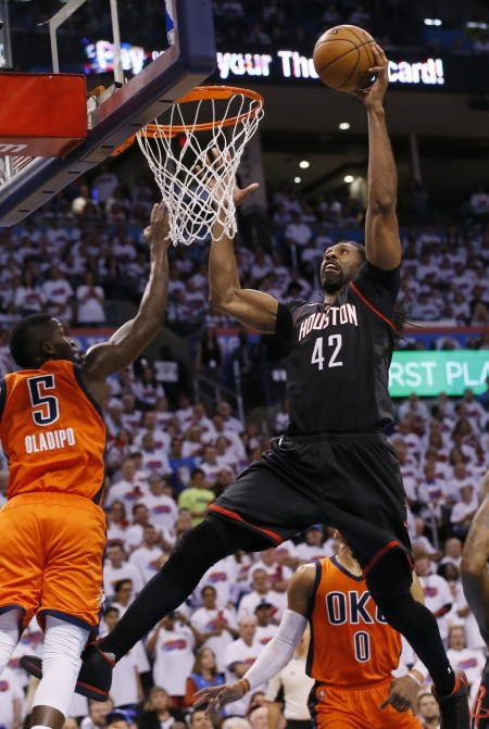 Houston Rockets center Nene (42) shoots in front of Oklahoma City Thunder guard Victor Oladipo (5) in the first quarter of Game 4 of a first-round NBA basketball playoff series in Oklahoma City, Sunday, April 23, 2017. (Sue Ogrocki/Associated Press)