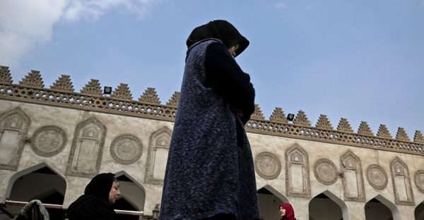 In this Feb. 20, 2017 file photo, an Indonesian al-Azhar university student, center, and an elderly Egyptian woman pray at al-Azhar Mosque, in Cairo, Egypt. (Credit: AP Photo/Nariman El-Mofty)