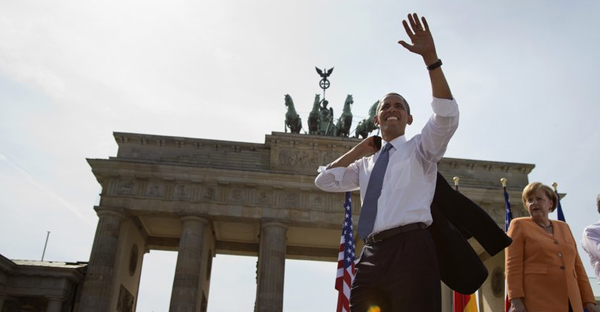In this June 19, 2013 file photo President Barack Obama, accompanied by German Chancellor Angela Merkel, waves to the crowd after speaking at the Brandenburg Gate in Berlin. Obama will return to Berlin to attend an event of the Lutheran Church conference end of May 2017. (AP Photo/Evan Vucci, file)