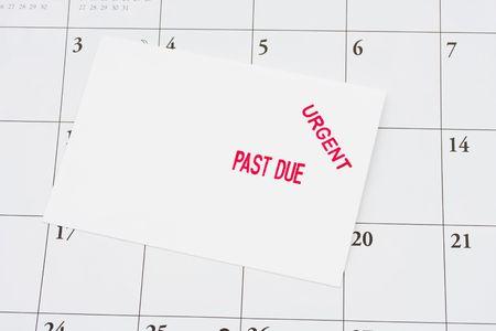 An Overdue Bill On A Calendar Background, Overdue Bills Stock - bill calendar
