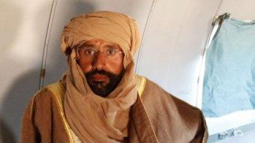 Gaddafi's son arrested in Libya; intelligence network crumbles