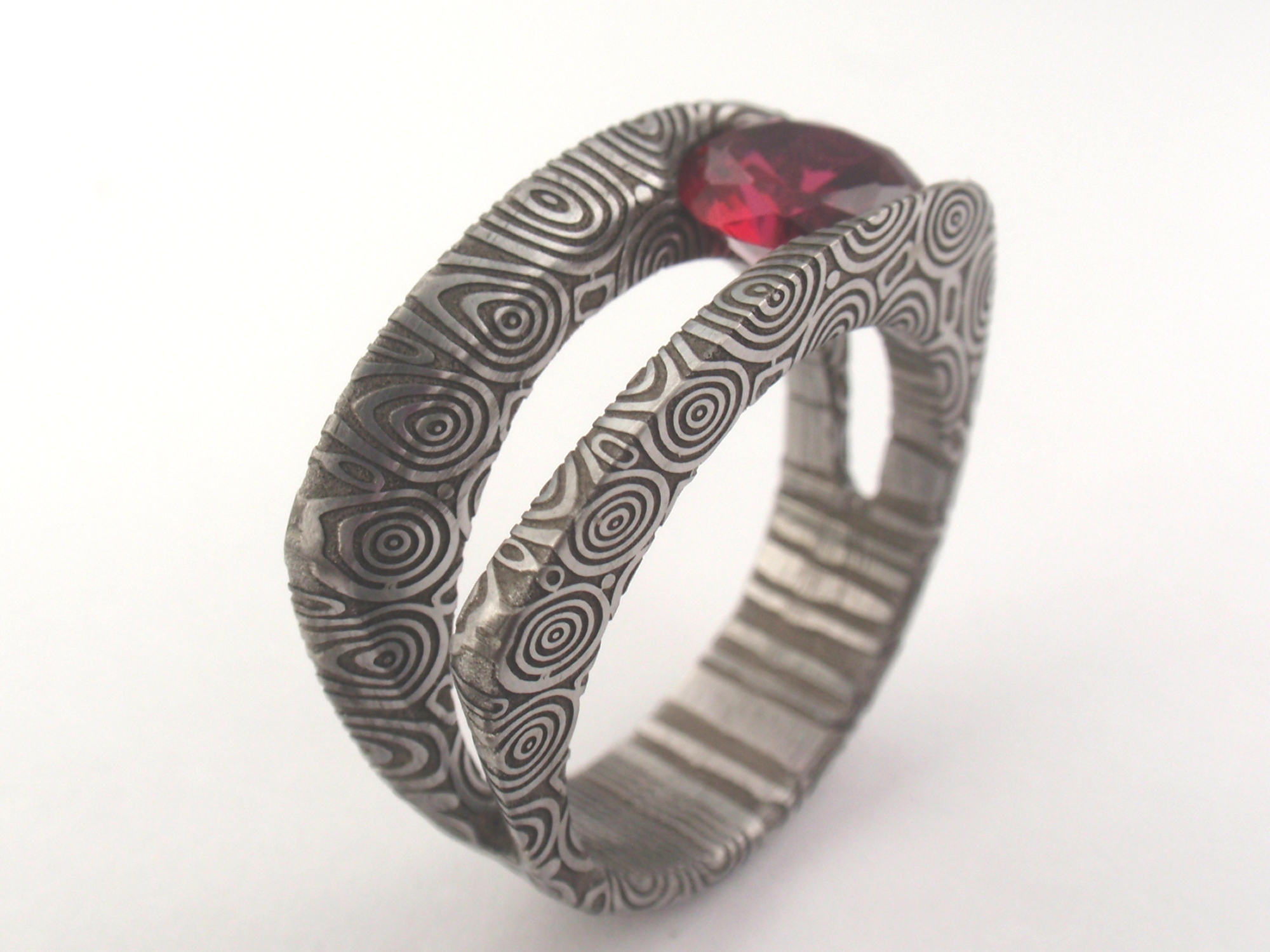 damascus stainless steel with birds eye pattern and ruby damascus wedding band Damascus with Birds Eye pattern and ruby