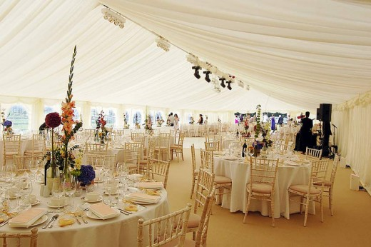 Tents 101 Your Guide to Renting a Tent for a Wedding or Party - wedding reception setup with rectangular tables