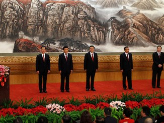 Chinese Communist Party General Secretary Xi Jinping, left, speaks as other new members of the Politburo Standing Committee, from second left, Zhang Gaoli, Liu Yunshan, Zhang Dejiang, Li Keqiang, Yu Zhengsheng and Wang Qishan, stand in Beijing's Great Hall of the People on Thursday 15 Nov 2012 | Image: AP Photo/Vincent Yu