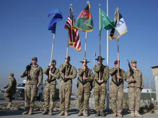 International Security Assistance Force (ISAF) taking part in a ceremony marking the withdrawal of U.S. and NATO combat mission in Afghanistan | Image: The Associated Press
