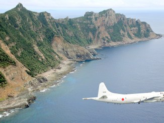 A Japan Maritime Self-Defense Force P-3C Orion surveillance plane flying over the disputed Diaoyu/Senkaku islands in the East China Sea on 13 October 2011 |  Image: NewsOK