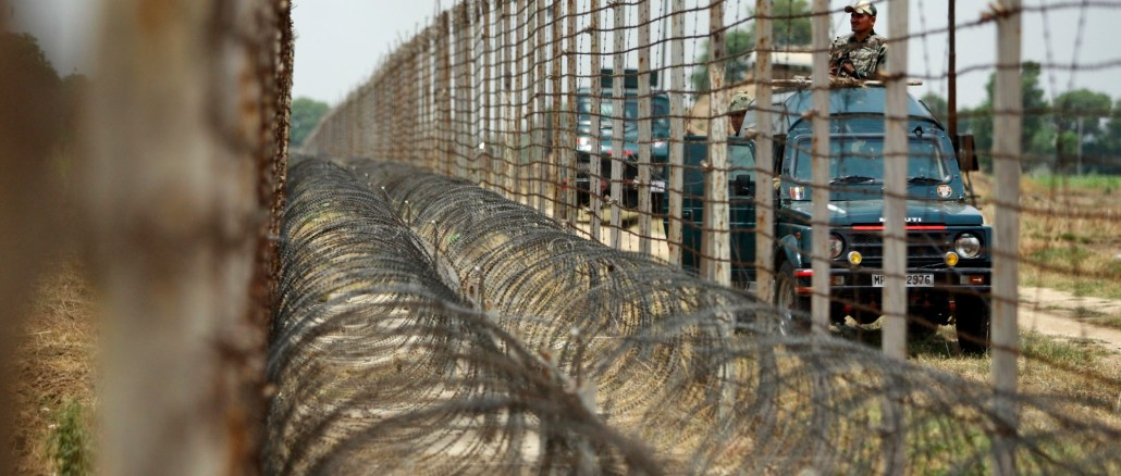 Indian Border Security Force soldiers patrol near the India-Pakistan border fence during the annual Chamliyal fair at Chamliyal post, about 47 kilometers (29 miles) south of Jammu, India, Thursday, June 26, 2014 I Images: AP Photo/Channi Anand