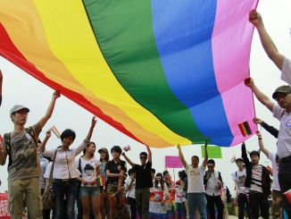 Activists brandishing a rainbow flag attend a gay pride procession in Changsha in South China's Hunan | Photo Credit: Zhou Qiang