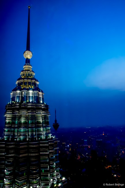 Top of Petronas Towers with Kuala Lumpur Tower in the distance