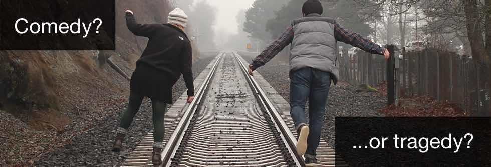 Two people walking on train tracks. Comedy or Tragedy?