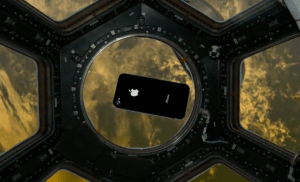 An iPhone floats in the International Space Station's cupola, in a promotional simulation by Odyssey Space Research.