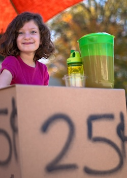 Girl running a lemonade stand