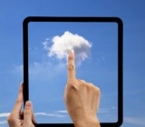 Hand pointing at a cloud in a virtual tablet
