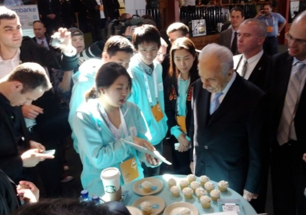 Shimon Peres checks out a demo of Between at LAUNCH