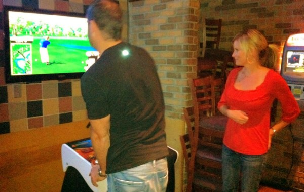 Douche playing Golden Tee Golf