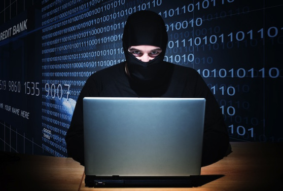hacker-with-computer-and-credit-card